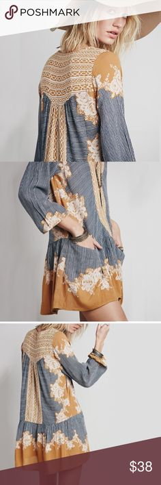 """Border Print Dropwaist Tunic DRESS Gold Yellow NEW BRAND NEW!! Effortless dropwaist tunic dress features a surplice V-neckline, front slip pockets, and a gorgeous mixed floral print for the perfect vintage vibe. Longsleeves and a flowy hemline round off a flattering silhouette. Pls note: this is an austin gal boutique item. Similar style by Free People.  100% Rayon Import  Measurements (M): Bust: 42.0""""  Length: 31.0""""  Sleeve Length: 25.0""""   Item is BRAND NEW, direct from the Manufacturer…"""