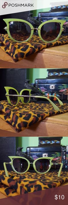 Green funky cat eye sunglasses Super cute funky green cat eye sunglasses. Accessories Sunglasses