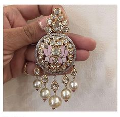 This gorgeous jadau earring with pearls and the most exquisite lotus detailing looks majestic! Earring By