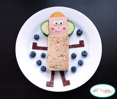 robot lunch from meet the dubiens blog    Robot - bologna sandwich cut into rectangle with a few heart sprinkles. Fruit leather legs and arms. Bologna head with icing eyes, heart sprinkles and food safe marker details. Cucumber and nilla wafer on the head. Blueberries to finish off the plate.