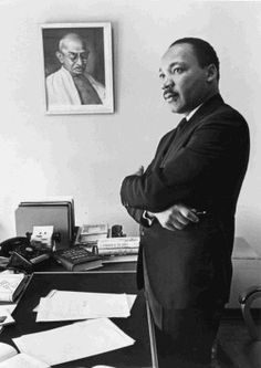 Martin Luther King, Jr. beside a picture  ofGandhi.
