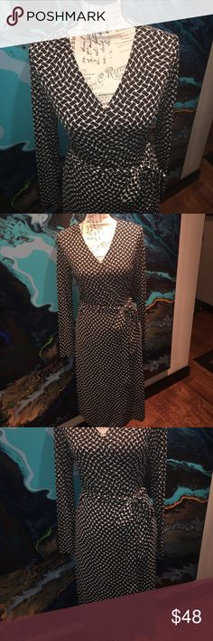 Work to Evening dress Black & White wrap dress. Great neckline! Wear a jacket to work then change jewelry for evening!! The Limited Dresses Midi