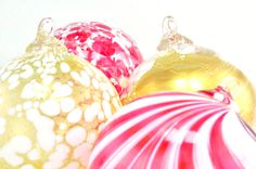 Hand-blown glass ornaments with gold leaf mixed with red and white glass ornaments makes for an elegant color palette.