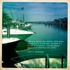 Photo of Nantucket Harbor with a quote from JFK