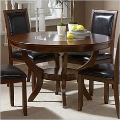 "Homelegance Avalon Round Dining Table in Low Sheen Cherry - This clean-lined transitional casual dining takes its roots from the art deco era of the 1930s. The Avalon dining collection is both straight forward and dramatic. Excitement comes from its simple yet elegant rectangular leg table and two round tab le options, streamlined bowed fronts bunching china with tear drop drawer pulls and its matched veneer drawer front design. The dark brown bi-cast vinyl chair with style and durability makes a statement of its own. Constructed of cherry veneers with select hardwoods in a contemporary low sheen cherry finish.  Features: Low Sheen Cherry Finish Round Dining Table Part of the Homelegance Avalon collection  Specifications: Overall product dimensions: 48"" Diameter x 30""H Product weight: 104.5 lbs."