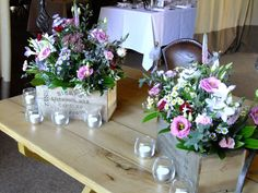 Wedding ceremony table decorated with rustic boxes of country flowers in pink and lilac.  Flowers by Honey Pot Flowers.  Venue The Tythe Barn, Bicester