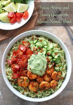 Creole spiced shrimp, fresh herbs and vegetables, and a luscious guacamole sauce top this shrimp ramen noodle bowl. Recipe at SoupAddict.com