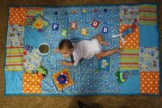 homemade Tummy Time Mat inspiration! So cute! maybe sister and I can make Noah his own special tummy time mat!