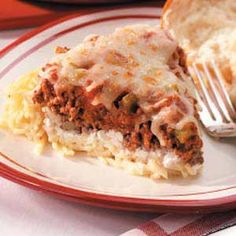 """Spaghetti Pie Recipe -A classic Italian combination is remade into a creamy, family-pleasing casserole in this quick and easy dish. """"This recipe was given to me several years ago,"""" notes Ellen Thompson from Springfield, Ohio. """"My family never grows tired of it."""""""
