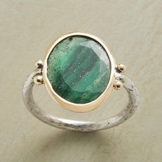 LUCKY YOU RING -- Some say green aventurine brings luck. In this sterling silver ring, it also brings compliments. 14kt gold bezel. Exclusive. Whole sizes 5 to 9.