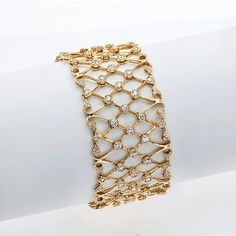 Gordon James Signature Lattice Bracelet; 8.00 carat total weight in Round Brilliant Cut Diamonds. Set in 18k yellow gold. http://www.gordonjamesdiamonds.com/products/diamond-bracelets/b-1877