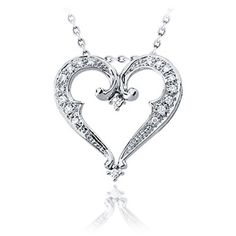 This #Victorian-inspired heart #pendant features #intricate filigree and swirls, and is #accented with subtly #sparkling #diamonds. The 14k #whitegold #heart #pendant is set with 16 G-H color, I1 clarity #round diamonds totaling 0.20ct. A matching 16-inch, 14k white gold chain is included. #Adiamor #Pushpresent