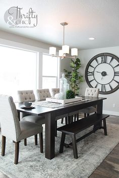 Dining room, Roman numeral clock,  plants, table #farmhouse #rug #elegant #bench #lighting #dinnertable #diningroom #largeclock #romannumeralclock #gray #elegant #modern #homedecor #diydecor #afflink #az
