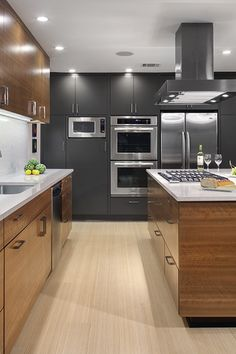 In this Merit award kitchen project, dark gray cabinets contrast with warm cherry cabinets. The countertops are Silestone's Blanco River. The project is by @C G&S Design-Build. Photo: Thomas McConnell #RDA2013