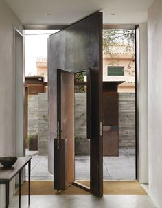 This entrance way has a metal door that can be opened in a traditional manner, or the entire wall can be rotated on a central axis. [600 x 771]