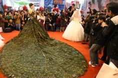 Strut-Worthy Wedding Gowns: incredible million dollars peacock feather dress shown at China Wedding Expo Peacock Wedding Dresses, Feather Prom Dress, Wedding Dress With Feathers, Peacock Dress, Black Wedding Dresses, Bridal Dresses, Wedding Gowns, Peacock Costume, Wedding Venues
