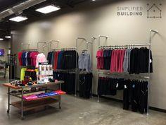 Industrial looking display racks that help you sell more clothing!  #clothingracks #retaildisplay