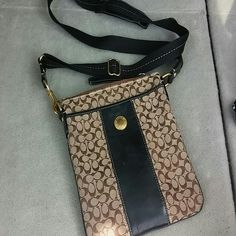 Coach Brown Logo/Black Leather Cross Body Bag Brown logo/black leather cross body coach bag. Good condition. Some minor wear(hence the price) on strap. Coach will clean for $25 Coach Bags Crossbody Bags