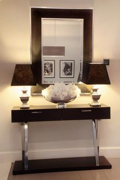 ENTRYWAY:  Sleek, contemporary dark wood and chrome entryway table, light floors and walls