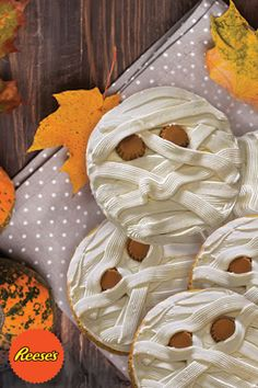 The best Halloween cookies come fresh from the oven with bites of a mummy and eyes made of REESE'S Peanut Butter Cup Minis. Perfect for any Halloween event, class party, or just fun at home!