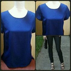 """Forever 21 Blue Top Cute blue short sleeve top by Forever 21. Top is a little shorter in the front with side slits. Has back zipper. The color is more of a cobalt blue. Looks great with skinny jeans, leggings, skirts. Great for casual look to the office. Wear tucked in or out, ad a belt.  Worn once. EUC. Measures approximately 23"""" long in the front and 25"""" long in the back. Material 100% Polyester. Soft and comfortable. Size Small. Forever 21 Tops Blouses"""