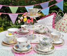 mismatched vintage china tea set with three-tiered cupcake stand