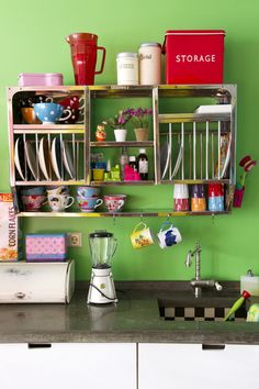 This vintage'y, green kitchen makes me happy! I love the idea of turning that shelving into office space, and keeping the coffee mugs on hand before a meeting!
