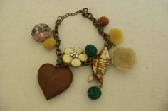 bracelet 11 different well made charms 8 1/2 long 1988   by ARTME, $7.88