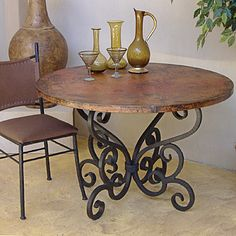 Love this table. I think I would do scrolled solid black iron chairs though