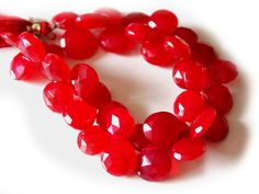 http://www.agajewelrydesigns.com/catalog/supplies/aaa-set-8-stones-chalcedony-red