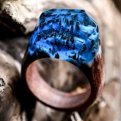 Wooden rings with tiny worlds inside. Amazing! I'm a size 10.