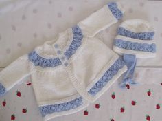 hand knitted   pretty jacket and bonnet  set baby / by bythemill