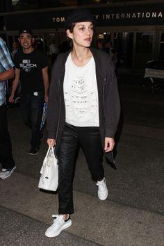 Celebrity Sneakers Style: Marion Cotillard wore Alexander McQueen sneakers for her travels.