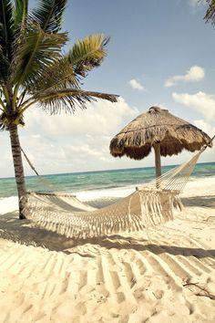 Sleep all day long on the beach in a hammock