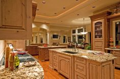 Luxury kitchen with 2 islands.  One island has a sink and the second is for dining