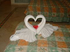 Beautiful heart shaped swans. Cruise Ship Towel Folding / Towel Origami. Uses 2 bath towels and 2 hand towels.