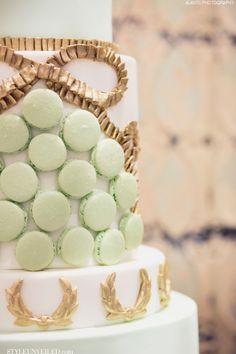 Sage Green Macarons on a Wedding Cake by The Sweet Side / Alante Photography / Seattle Wedding Cakes / via StyleUnveiled.com