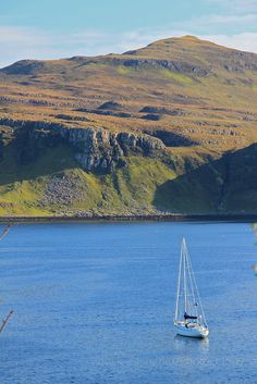 A lone yacht in the harbour of Portree, on the Isle of Skye, Scotland