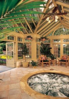Furnished in rustic accents as well as natural stone and premium wood, this glass conservatory is perfect for a luxurious soak in the spa. Tanglewood Conservatories, Ltd. http://www.luxurypools.com/blog/entryid/113/6-beautiful-backyard-conservatories.aspx#
