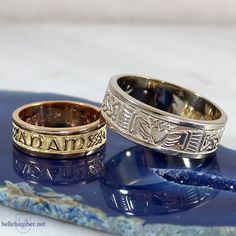 A Celtic Wedding ring set.  The yellow gold Gaelic Mo Anam Cara ring & a Celtic Claddagh Loveknot ring in white gold.