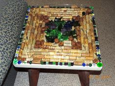 Mosaic Wine  Table-  this one of a kind table is designed for the wine lover.  It is made with stained glass, corks, and resin by MosaicsofGlass on Etsy https://www.etsy.com/listing/198258679/mosaic-wine-table-this-one-of-a-kind