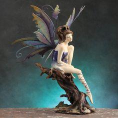 Purple Fairy Figurine on Tree