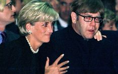 *JULY 22,1997: Diana comforts Elton John as he weeps  at a memorial mass for Gianni Versace in Milan