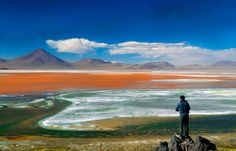Laguna Colorada, southwestern Bolivia  This shallow salt lake, dotted with white borax islands and feeding flamingos, is one of the largest bodies of water within the well-visited Eduardo Avaroa Andean Fauna National Reserve. Photo: Ana Caroline Lima