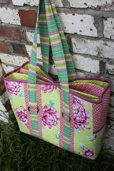 "The Multi-Purpose Carry All Bag is a beautiful bag suitable for many and varied functions. It has large external pockets, many varied size internal pockets and an interior gusseted divider section 2"" wide padded to protect all your fragile valuables.  Pdf pattern available for purchase from Sew Well Maide (the commercial face of Knitting Maide) www.etsy.com/listing/107576656/tote-bag-pattern-the-multi..."