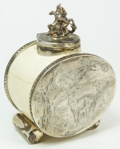 Antique Russian silver and ivory inkwell having hinged cover with figural St. George and the Dragon finial mounted to cylindrical body