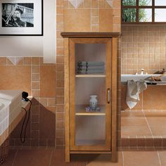 @Overstock.com - Chamberlain Floor Cabinet - Give your bathroom extra storage space with this spacious bathroom floor cabinet from Chamberlain. The cabinet's oil-oak finish will warm up your space while its two adjustable shelves will allow you to customize the space to suit your storage needs.  http://www.overstock.com/Home-Garden/Chamberlain-Floor-Cabinet/7233235/product.html?CID=214117 $105.99