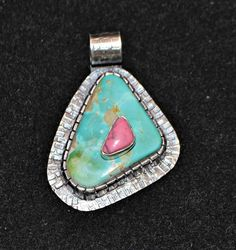 Stone on Stone Pendant with Jeff Fulkerson. In this class you will learn how to drill a hole in a cabochon to allow you to set another stone on top of it. You will learn how to make cuts in your bezel with a cut-off wheel and how to solder small components without melting everything!