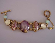 """Stephen Dweck """"O.A.K"""" (one of a kind) bracelet, chalcedony and agate set in bronze (an alloy of copper and tin or other metals), 7"""" by 1-3/16"""" at front and 1/3"""" bead at back, marked on the back of the center stone """"Stephen Dweck"""""""