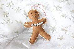 Want to make one and hang it https://www.etsy.com/listing/246680375/christmas-decoration-personalised